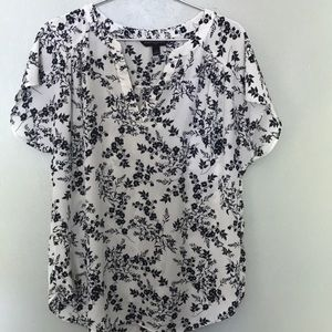 White and navy floral blouse